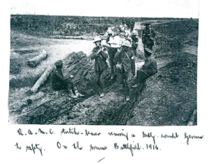 R.A.M.C. stretcher–bearers removing a badly wounded German to safety on the Somme Battlefield 1916.