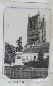 The Abbey Tower and statue of Jaqueline Robin.