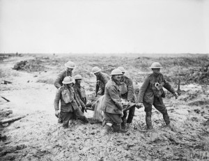 Stretcher bearers at Boesinghe a short way north of Ypres, to the west of the canal on the 1st August 1917. Copyright: © IWM. Original Source: http://www.iwm.org.uk/collections/item/object/205193365