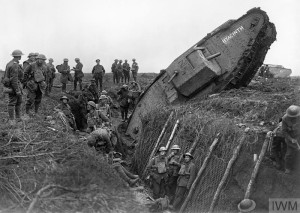 A Mark IV (Male) tank ditched in a German trench. Some men of the battalion are resting in the trench, 20 November 1917.