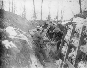 Men of the 15th Battalion Royal Welch Fusiliers (London Welsh) filling sandbags with the earth excavated from of a dug-out in their trenches at Fleurbaix, 28 December 1917. Copyright: © IWM. Original Source: http://www.iwm.org.uk/collections/item/object/205244250 © IWM (Q 8372)