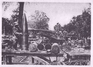 German artillery troops preparing the monster 38 cm gun clearly showing the size of a shell.