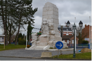 Photo © Ray Coggin. The War memorial in Merville, damaged in a subsequent Battle of the Lys in May 1940