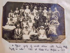 A typical group of wounded soldiers with nursing staff, myself in centre. Taken at Chester War Hospital in 1918.